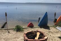 Enjoy the upper beach area, complete with corn hole equipment, ladder-ball, and your private fire pit area pre-stocked with a large supply of firewood.