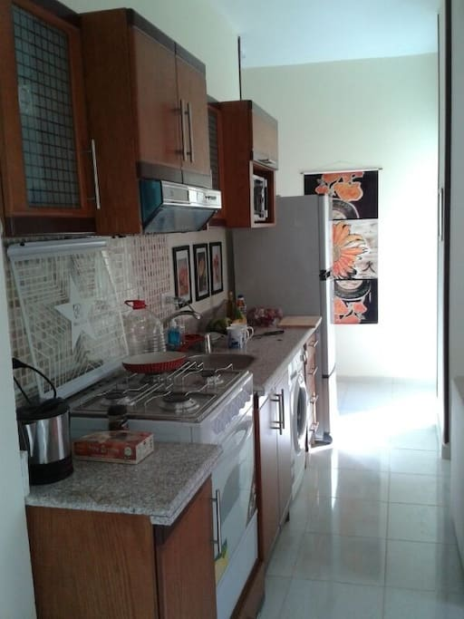Kitchen with all appliances and clothes washer.