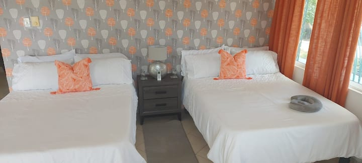 2 double bed and 1 sofa-bed in a large room