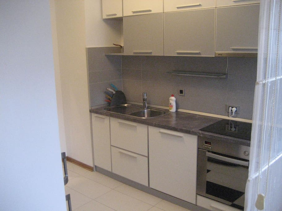 Fully equipped kitchen where you can prepare your meals. A kitchen has access to a terrace