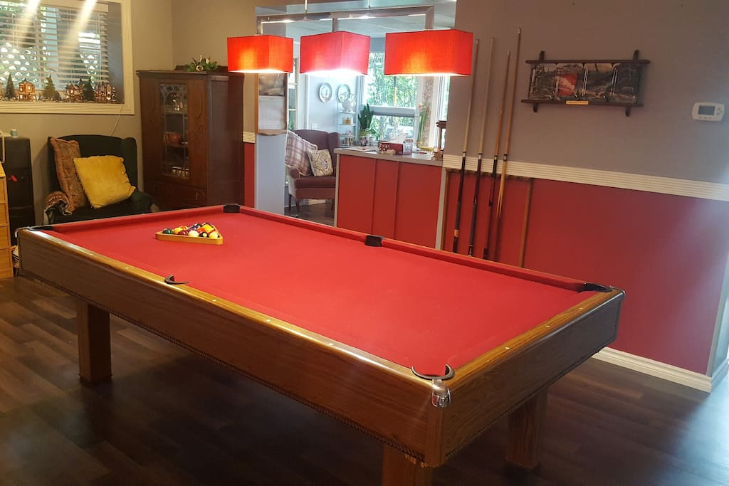 Pool table and beverage bar area, have a drink and a game.