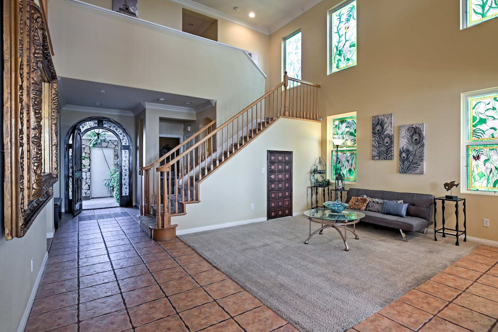 The 3,100 square feet of tasteful living space offers red tiling, plentiful natural light, and elegant decor.