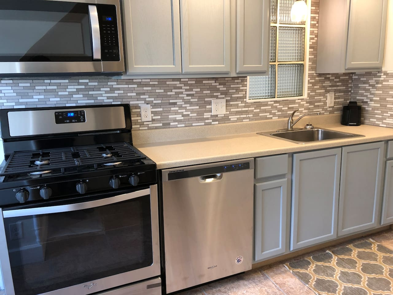 Newly updated kitchen with gas stove, stainless appliances, recess lighting and dishwasher
