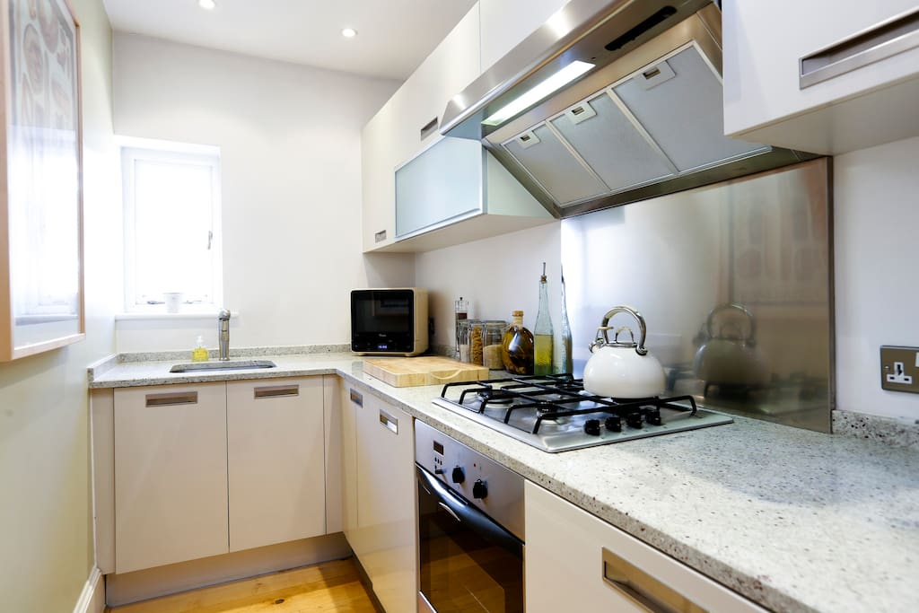 Modern galley kitchen fitted with all mod cons