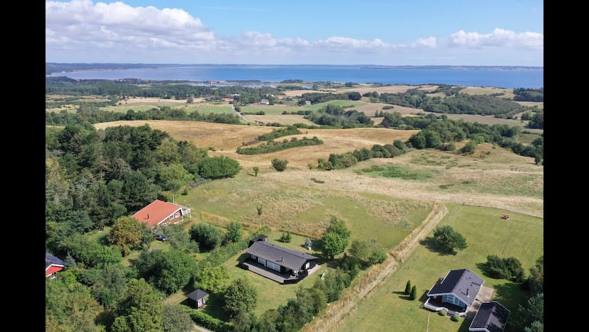 Drone view northeast towards Ebeltoft. The house is (red roofed) to the left.