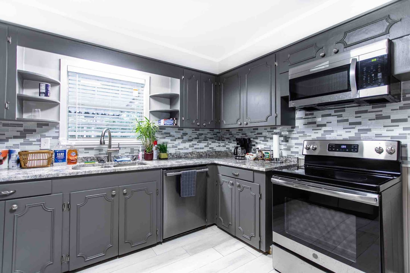 Brand new kitchen with stainless steel appliances. Everything you need to cook is here.