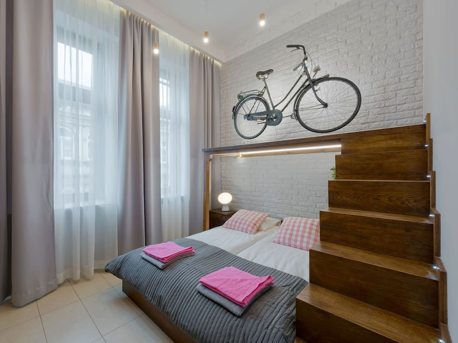 Second bedroom with stairs and bike