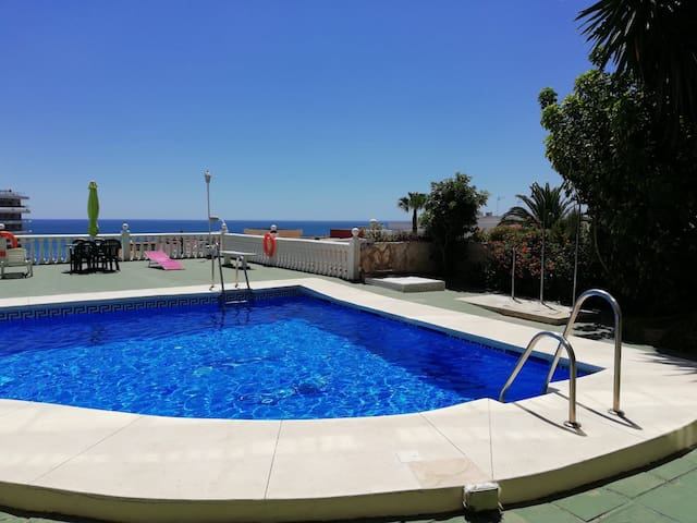 Stunning studio, Seaview with balcony and pool.