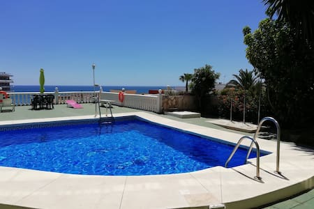 Stunning studio, Seaview with balcony and pool.