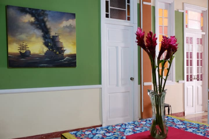 Casa el Remanso is a spacious Cuban apartment, featuring cathedral ceilings, French doors and long corridors throughout the entire space.