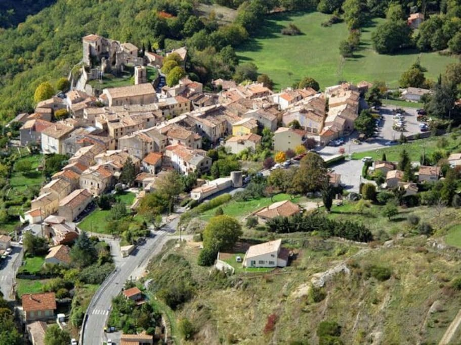 Aerial view of the village of Greolieres, as seen from a paraglider