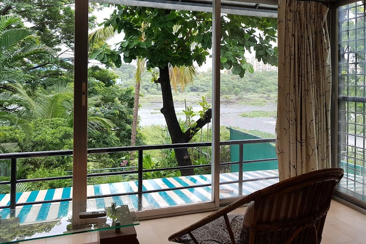 Unobstructed River view from the bedroom. Huge glass windows.