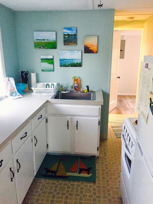 Kitchen  is fully equipped with a coffee maker, toaster, microwave, refrigerator, stove, pots and pans