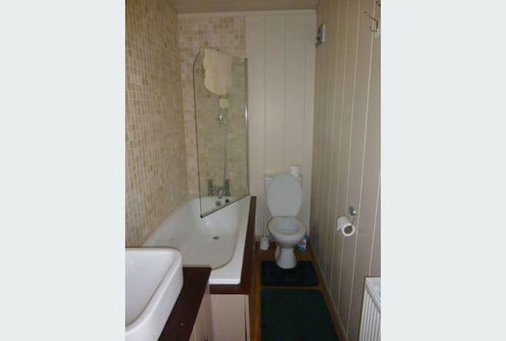 Bathroom 1 with shower, bath, toilet and basin.