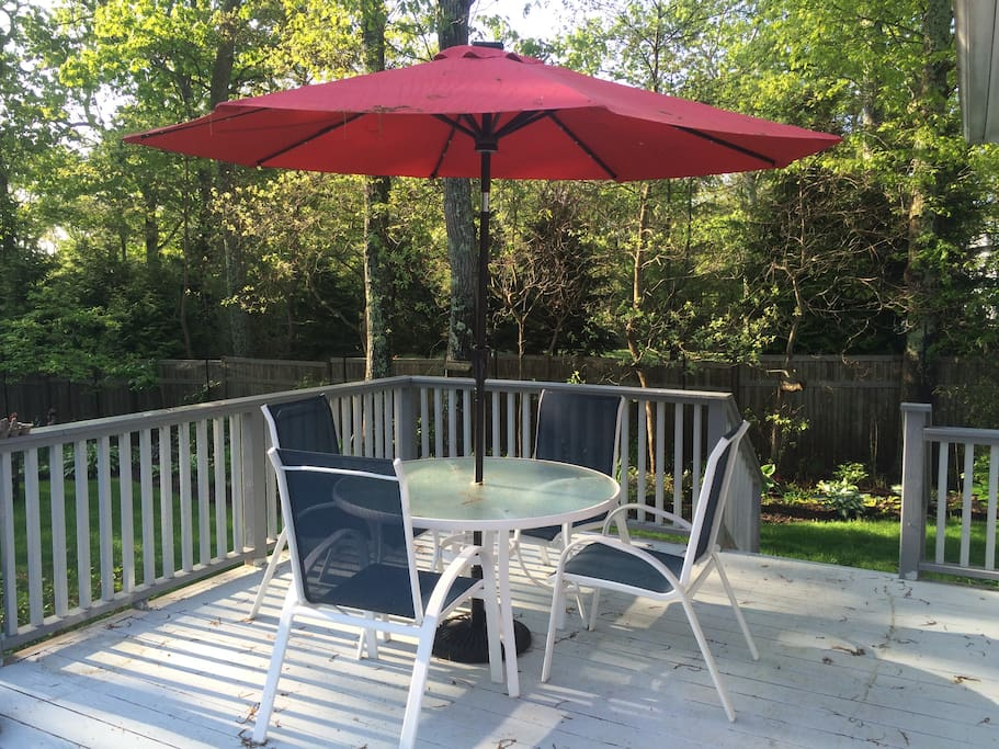 Outdoor table and chairs available for guest use.