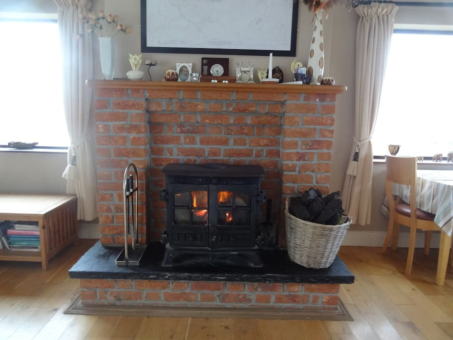 Turf fire in sitting-dining room. Nothing as nice on a cold evening!