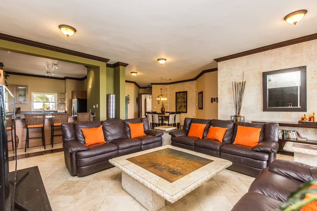 Tropical inspired décor with ample areas for lounging and entertaining