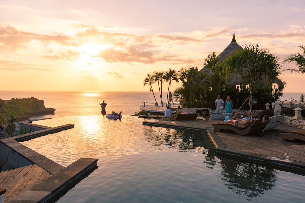 Three-tier honeycomb infinity pool during sunset. Hear the ocean waves below.