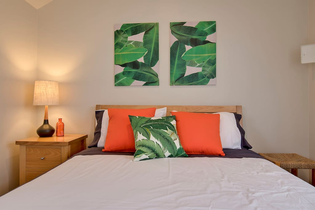 Large room with queen bed and fresh linen