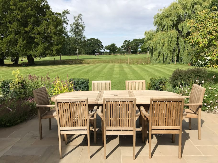 Alfresco dining overlooking the pond and fields