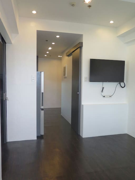 The Living- Dining area with a wall TV