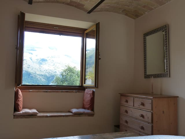 Bedrooms have window seats and mountain views