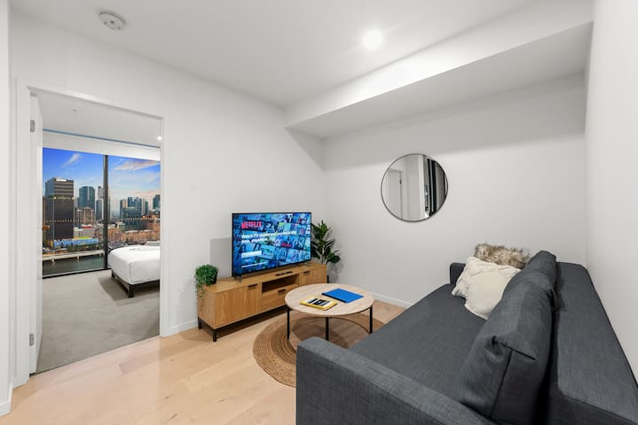 My comfy air-conditioned living room. That is a 4K Smart TV with Netflix capabilities. You will be able to watch practically anything!  I have tried to make the whole apartment as homely and comfortable for you as possible.