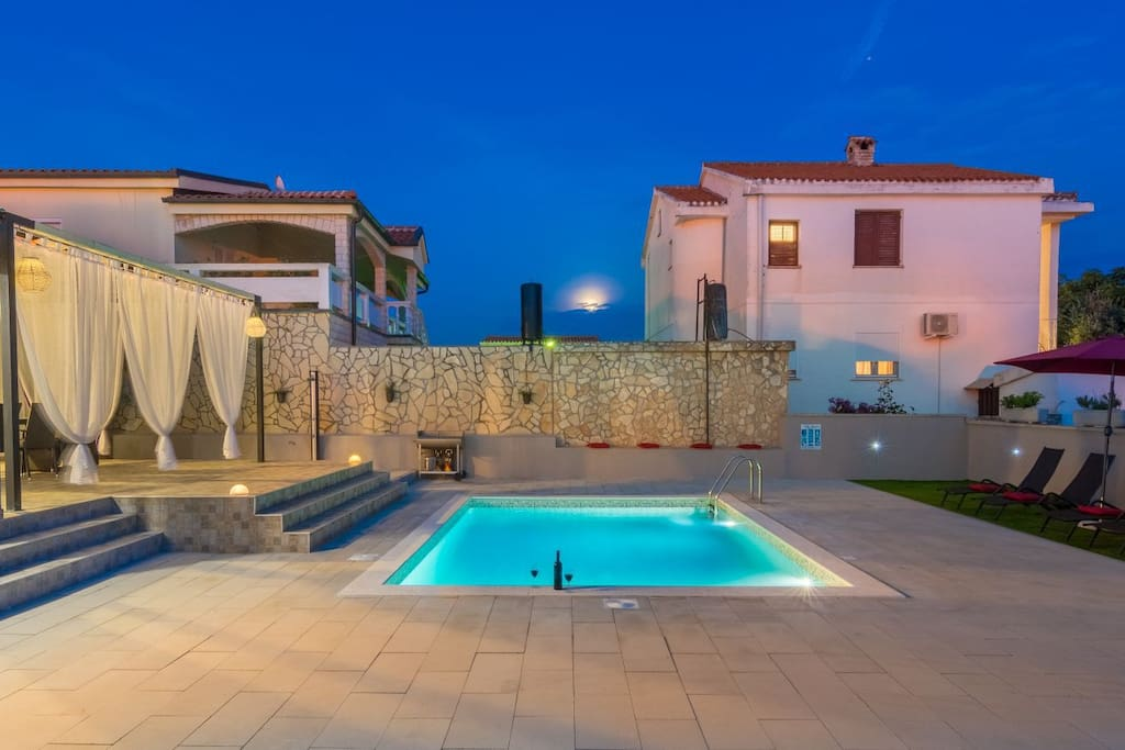 Villa Laura's pool in the evening