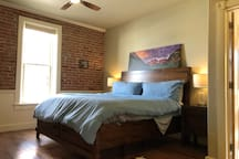 Make yourself comfortable in the master bedroom with tons of light, a ceiling fan, walk-in closet, desk, and TV.