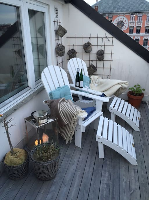 30 square meters balcony with a large dining table, deckchairs and still a lot of space to enjoy the spectacular panorama view over North, East, and South of Oslo