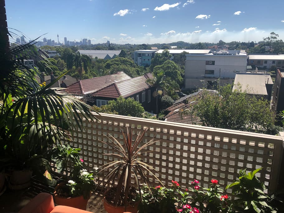 Lush, sun drenched balcony for autumn and winter sun basking while admiring the view across Centennial Park to the city.