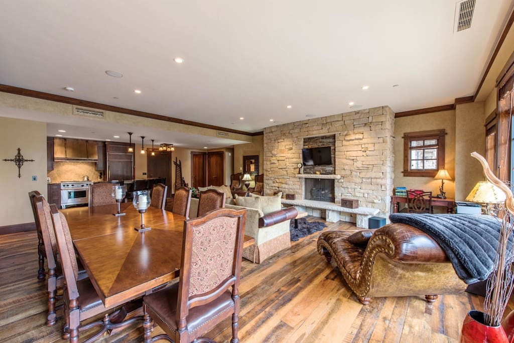 Relax each day in designer leather furnishings or warm up next to the custom fieldstone fireplace with floor to ceiling windows and views of Deer Va
