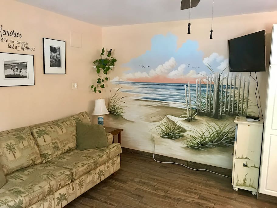 Living room with mural accent wall
