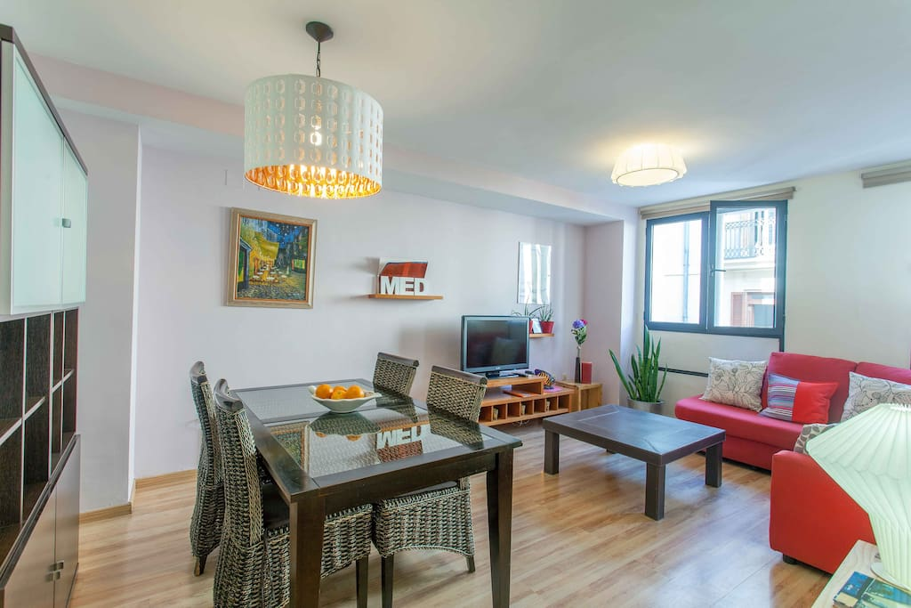 The living room is spacious with a comfortable sofa, a dinning table for 4 people.