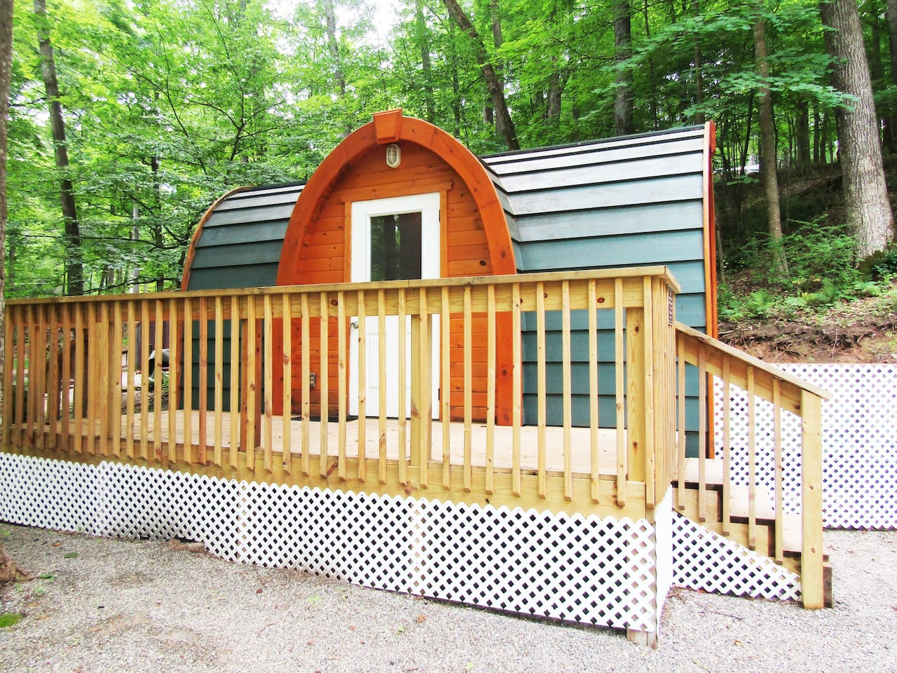 The exterior of our Hideaway Hut has a small deck for sitting.