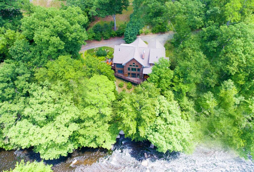 Aerial shot of home on river