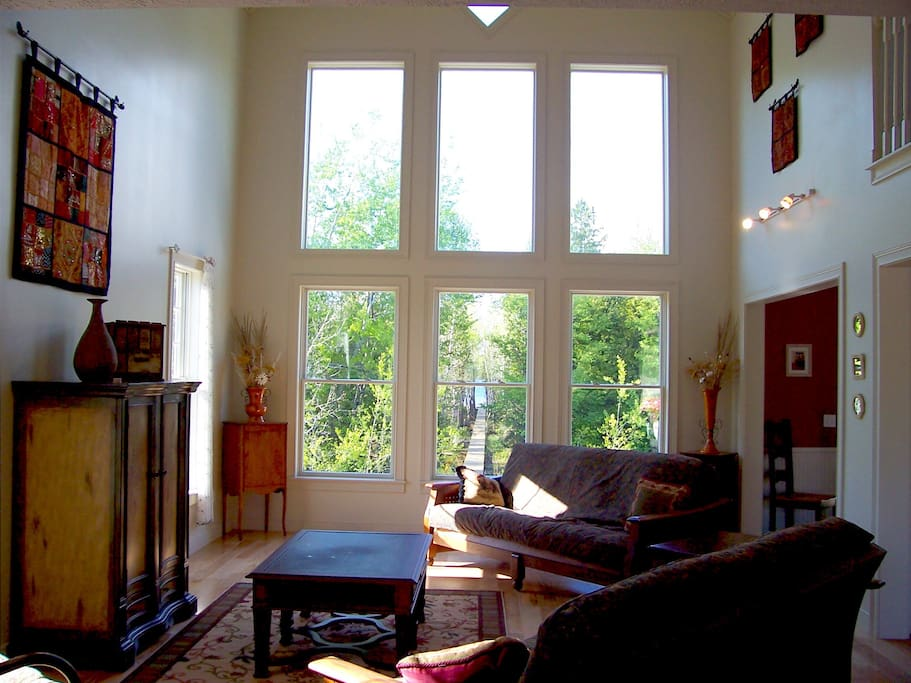 Great room (you can see path to water's edge in middle window)