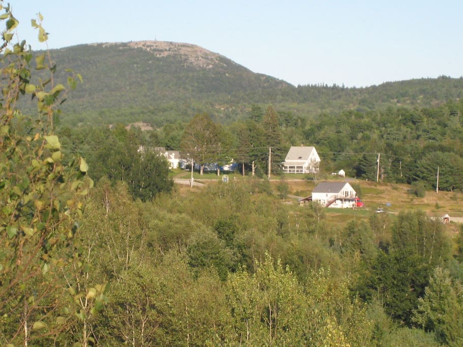 Our house has the steeply pitched roof at upper right. We are located below Schoodic Mountain, a prominent landmark in the area.   There are wonderful hiking trails and swimming holes nearby.