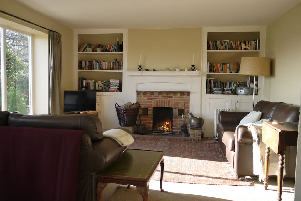 Sitting room with open fire, books, games, TV, local info