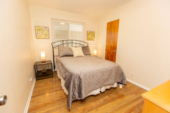 Bedroom #3 is adjacent to the kitchen and features a double bed.