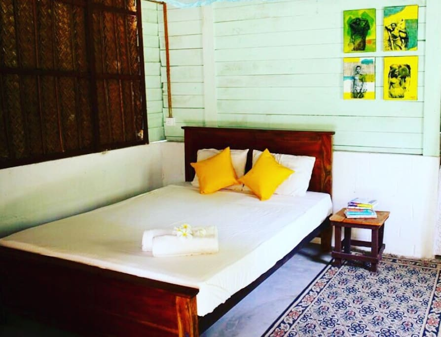 Our cabanas are individually designed rustic, traditional and with pops of colour! Check out our unique artworks.  This is an interior glimpse of cabana 4.