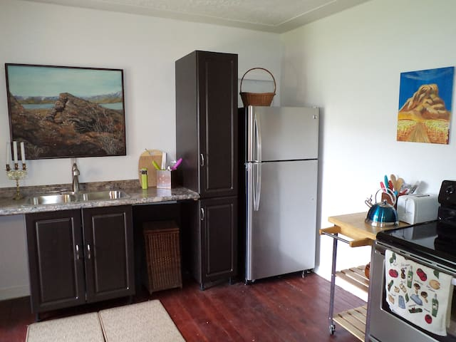 Kitchen has full stove with large oven & micro-wave, Indoor dining area seats 6