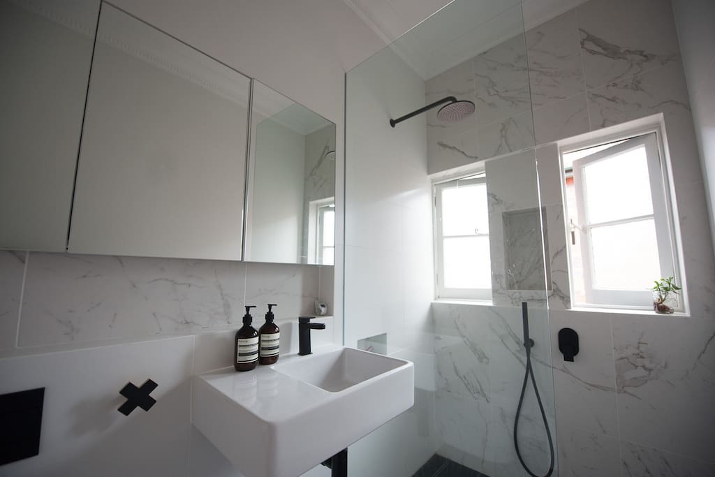 A newly renovated bathroom with amazing rain shower head - there is a big hot water heater, perfect for long showers!