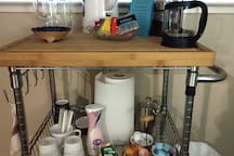 """Self Serve Coffee Bar  Includes: Regular & Decaf Fair Trade Coffee, Hot Cocoa, a Variety of Tea, assorted Creamers including Almond milk creamer and sugars. China mugs & """"to-go"""" cups. Plenty of fresh filtered water for beverages when you are ready."""