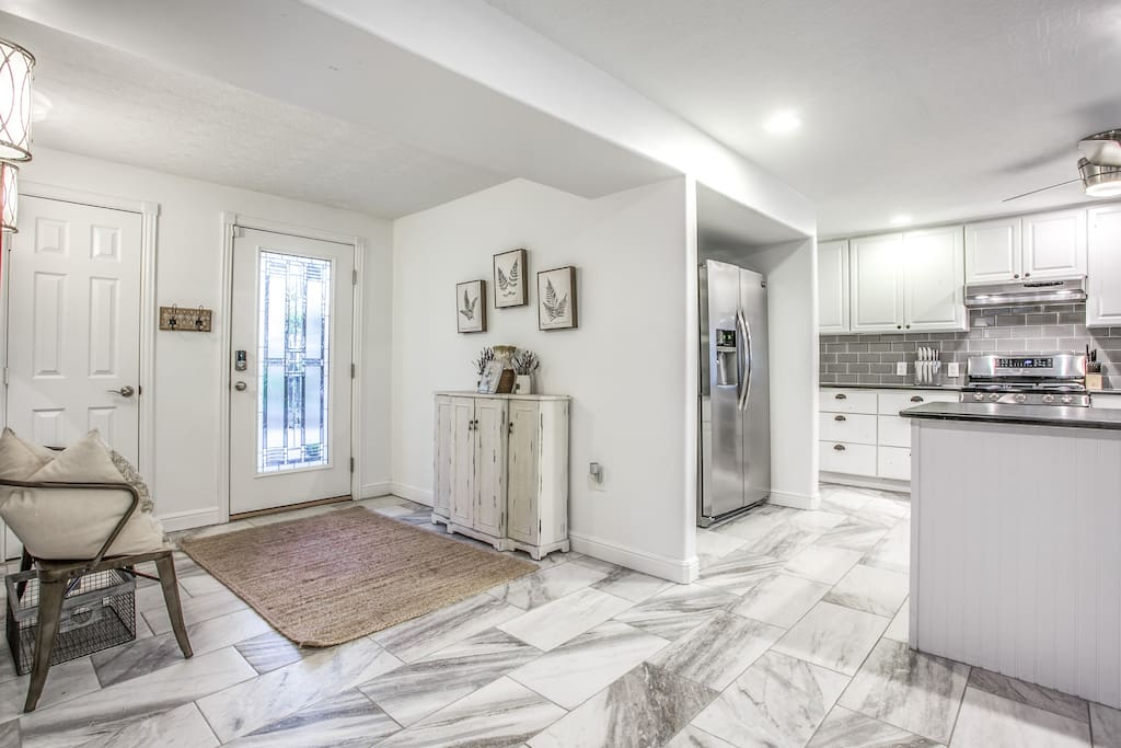 Front Entry:  Walk in through the front door into the open floor plan kitchen and dinning area.  You will feel at home as soon as you step in and close the door.