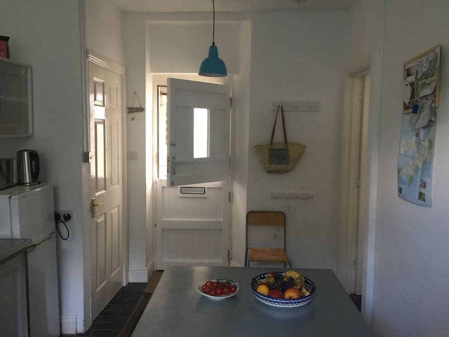 The barn door entrance to the kitchen