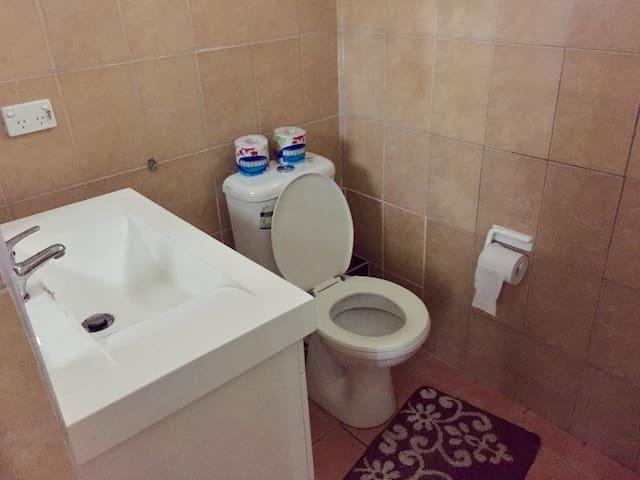 Toilet in the master bedroom