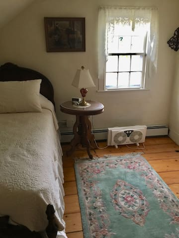 Twin bed with extra mattress underneath