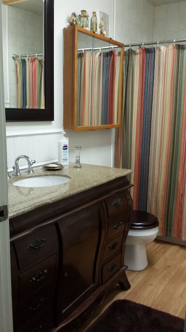 Our two guest rooms share this full bathroom located just outside the two bedrooms.