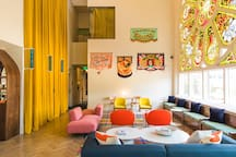 Our fun and vibrant hotel lobby with original stained glass windows, a photo booth, coffee, and more!